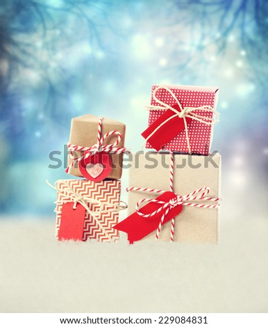 Small Handmade gift boxes in shiny blue night  - stock photo