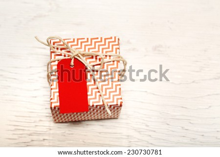 Small handmade gift boxes on wooden table - stock photo