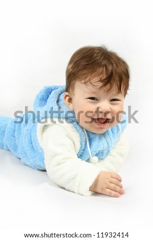 Small happy child with blue clothing against the white background