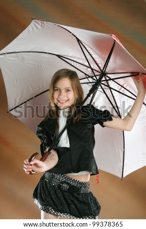 small, happy little girl with umbrella