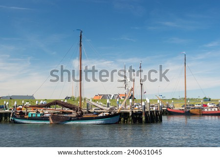 Small harbor in Oudeschild at Dutch wadden island Texel - stock photo