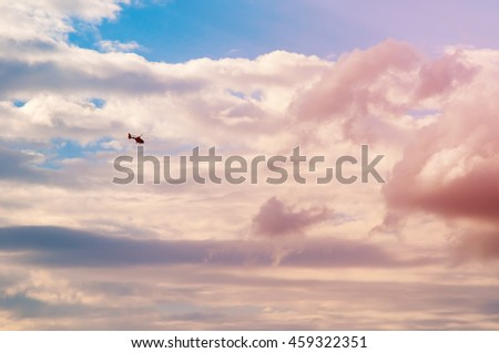 Small helicopter in the sky background