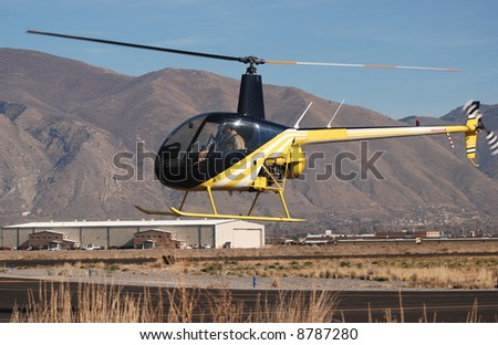 Small Helicopter Landing - stock photo