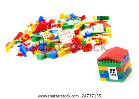 Small house and construction set isolated on white - stock photo