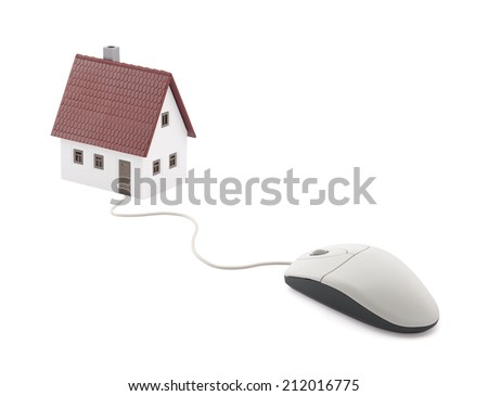Small house connected to computer mouse - stock photo