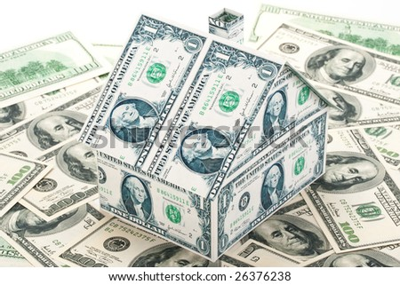 Small house from banknotes on a background from money