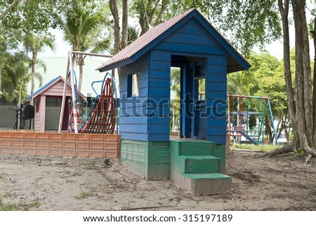 Small house in playground. - stock photo