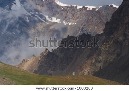 Small house in the mountains, Kyrgyzstan - stock photo