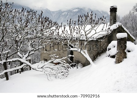 Small house in the snow, Dolomites scenery