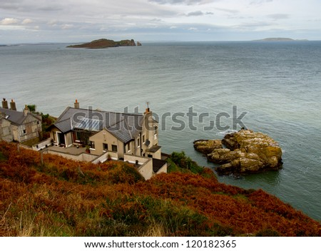 Small house on a Cliffs near Howth town. Ireland. - stock photo