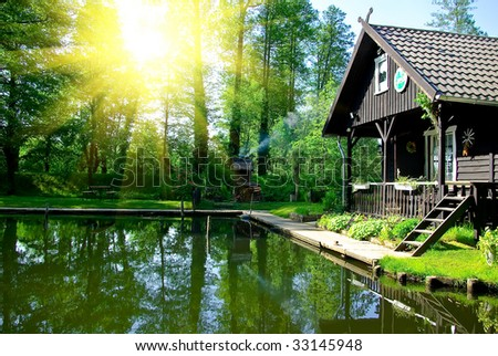 Small house on lake - stock photo