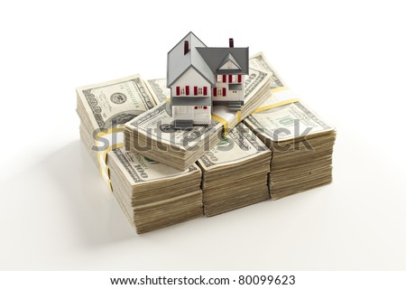 Small House on Stacks of Hundred Dollar Bills Isolated on a White Background. - stock photo