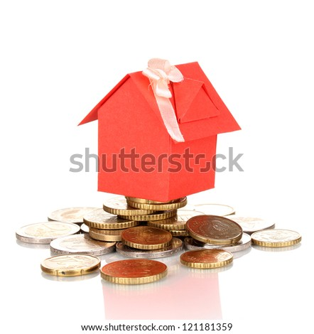 Small house standing on heap of coins