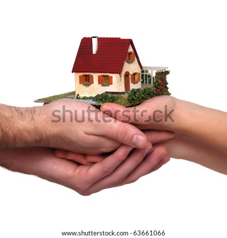 small house stands on the four arms of the family - stock photo