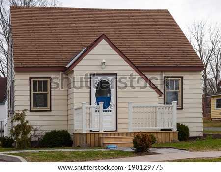 Small house with a front porch - stock photo