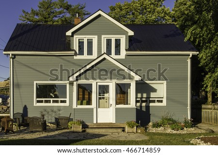 Small house with grey siding