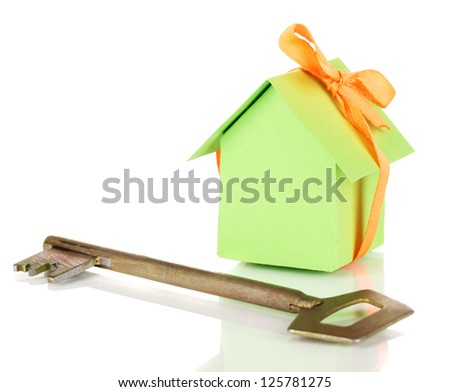 Small house with key isolated on white