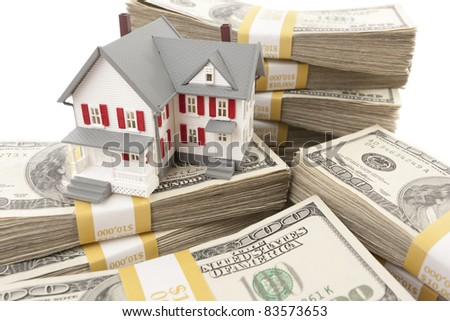 Small House with Stacks of Hundred Dollar Bills on White. - stock photo