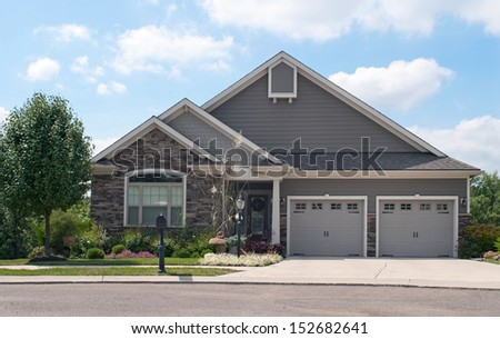 Small House with Two Car Garage - stock photo
