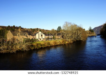 Small houses near the Loch Ness in highlands, Scotland - stock photo