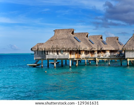 small houses on water - stock photo