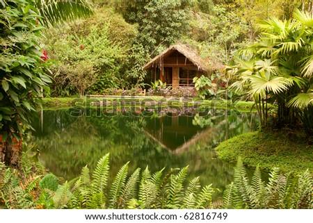 small hut in front of a lake in Ecuador , Mindo region - stock photo