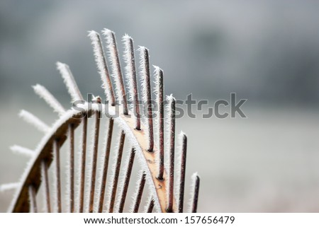 Small ice crystals on farming machinery - stock photo