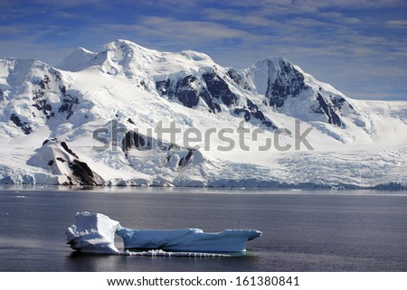 Small iceberg in front of Curville Island, Antarctica - stock photo