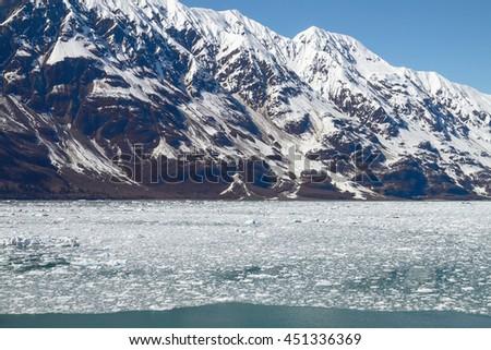 Small Icebergs Floating in Sea Close to Hubbard Glacier in Alaska. - stock photo