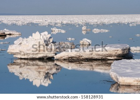 small icebergs reflecting in the sea