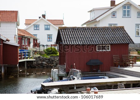 Small idyllic fishing village on one of the many islands in the swedish archipelago. - stock photo