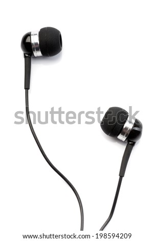 Small in-ear headphones isolated on white  - stock photo