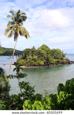 Small island in the bay and palm trees on the coast in Upolu, Samoa - stock photo