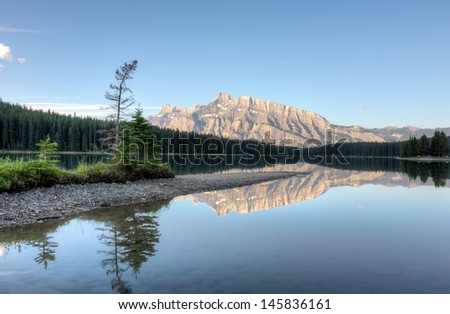 Small island in Two Jack lake. Banff National Park, Alberta, Canada. - stock photo
