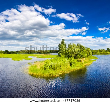 Small island on lake on sunday - stock photo