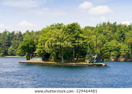 Small island with a cottage on St.Lawrence River in Ontario
