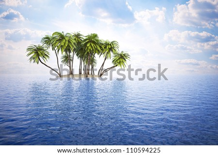 small island with palm trees in the blue ocean. - stock photo