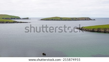 Small islands off the west coast of the main Shetland island, which is located northeast of Scotland, United Kingdom - stock photo