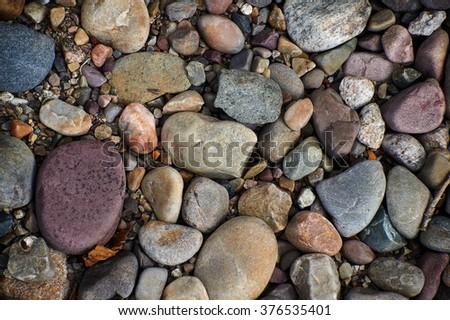 Small jackstones on the ground - stock photo