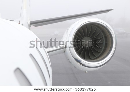 Small jet engine on the left hand side of the plane