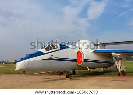 Small jet on a parking place - stock photo