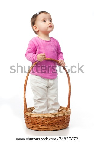 small kid in the basket on a white background - stock photo