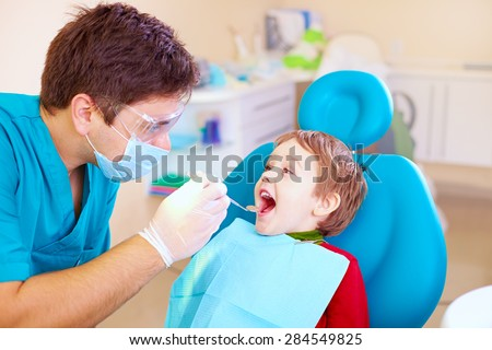small kid, patient visiting specialist in dental clinic - stock photo