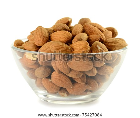 Small kitchen dish with almonds isolated on white - stock photo