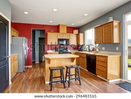 Small kitchen with island, also red and gray walls. - stock photo