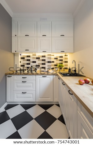 Small Kitchen With Modern Black And White Floor Tiles