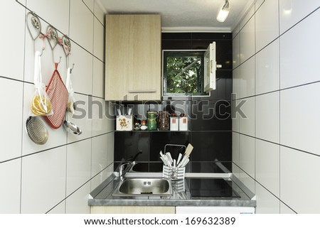 Small kitchen with white tiles on the wall - stock photo