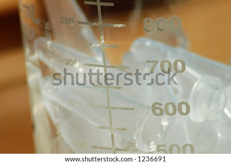 Small Laboratory Tubes in a Beaker - stock photo