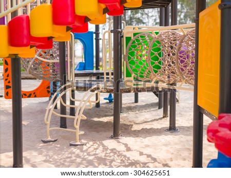 Small ladder and crawl rope net pipe on modern kids playground
