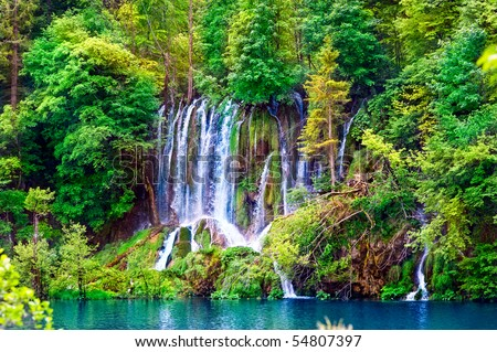 Small lake and waterfall - stock photo